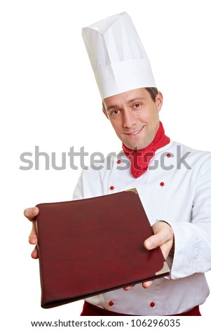 happy chef cook offering a menu card - stock photo