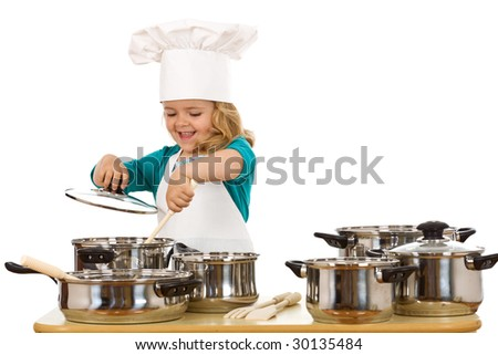 Happy chef girl stirring soup in a bowl - isolated - stock photo