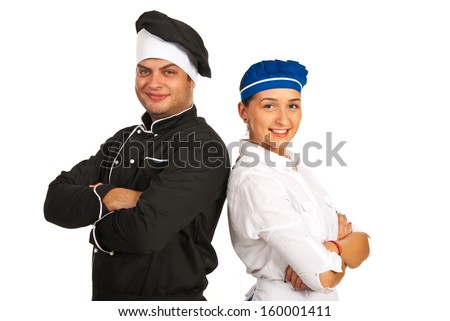 Happy chef male and waitress standing back to back with hands crossed - stock photo