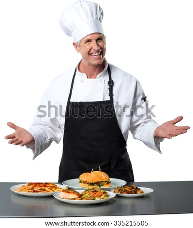 Happy chef presenting different kind of food in front of him - Isolated