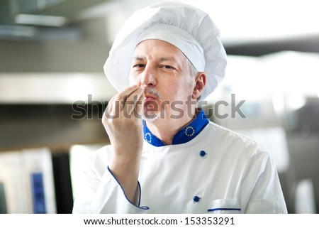 Happy chef satisfied for his good work - stock photo