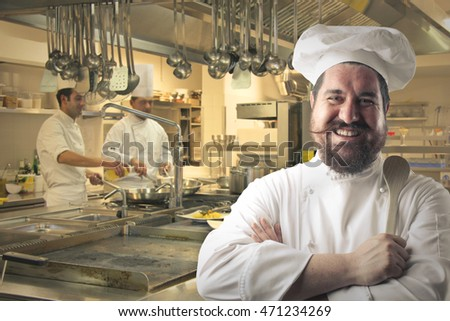 Happy chef smiling in a restaurant kitchen