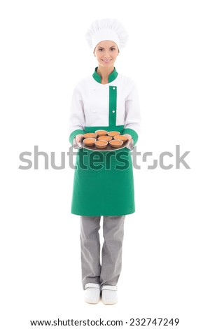 happy chef woman in uniform holding tray with muffins - full length isolated on white background - stock photo