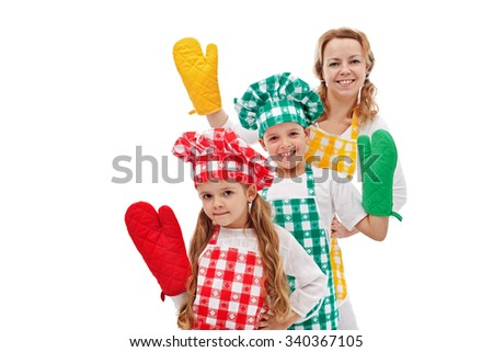 Happy chefs waving to you - kids with their mother wearing large kitchen gloves, isolated - stock photo