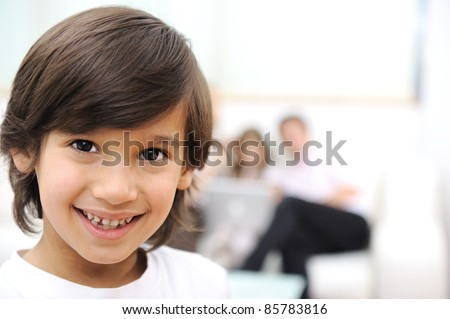 Happy child at home with family - stock photo
