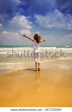 Happy child at the beach. Kid having fun outdoors. Summer vacation and freedom concept. Healthy lifestyle - stock photo