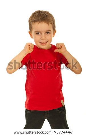 Happy child boy pointing to his  red blank t-shirt isolated on white background