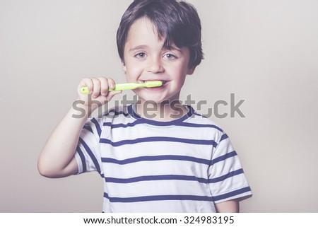 happy child brushing her teeth - stock photo