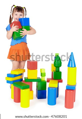 Happy child builds a castle out of color blocks - stock photo