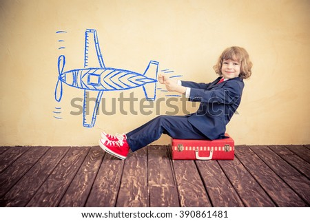 Happy child businessman with suitcase. Summer travel and business trip concept - stock photo