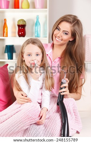 Happy child cleaning her nose - stock photo