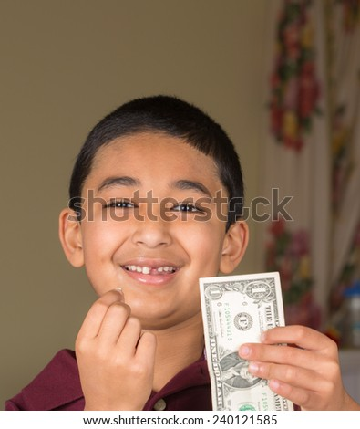Happy Child Displaying Fallen Tooth and Money Gifted by the Tooth Fairy - stock photo