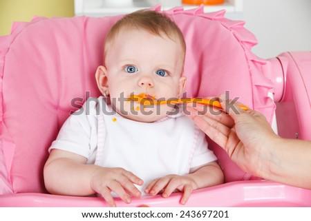 Happy child eating carrot - stock photo