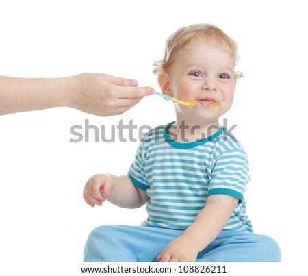 happy child feeding - stock photo