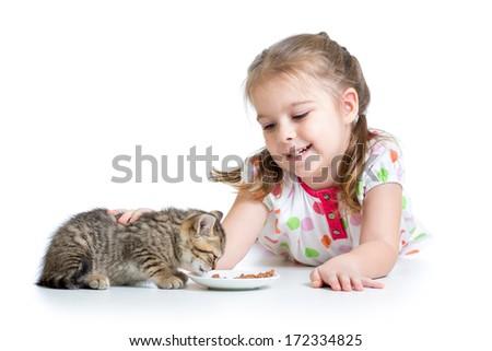 happy child feeding kitten - stock photo