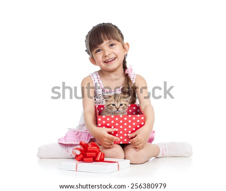 happy child girl holding gift box with cat kitten - stock photo