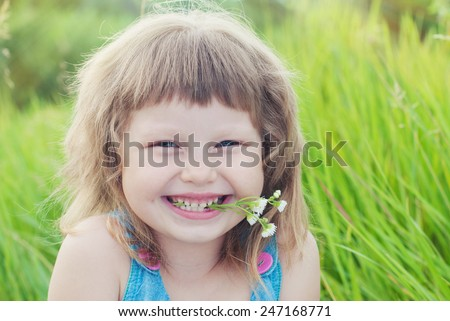 Happy Child Girl in green grass at Summer. Healthy Lifestyle. Happy Children