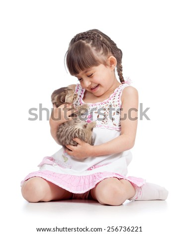 happy child girl looking at kitten isolated