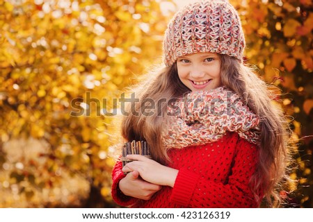 happy child girl on autumn walk in forest