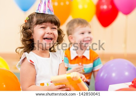 happy child girl with colorful balloons and gift - stock photo