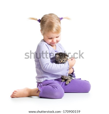 happy child girl with kitten - stock photo