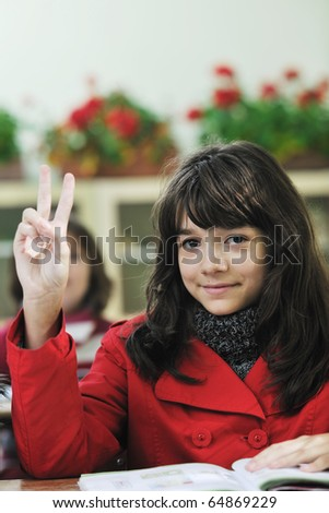 happy child  group in schoold have fun and learning leassos while looking for solutions and problems and rise a hand - stock photo