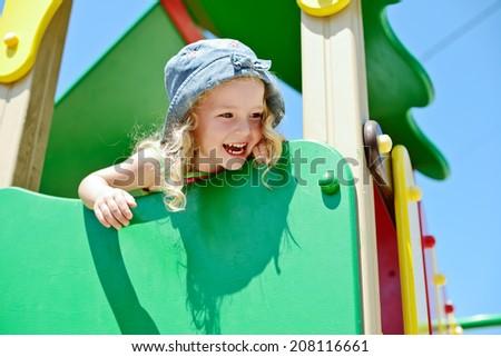 happy child having fun on the playground - stock photo