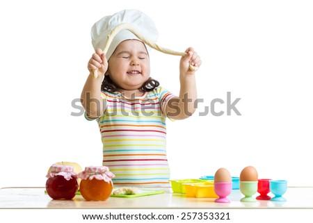 happy child having fun preparing a pie in kitchen - stock photo