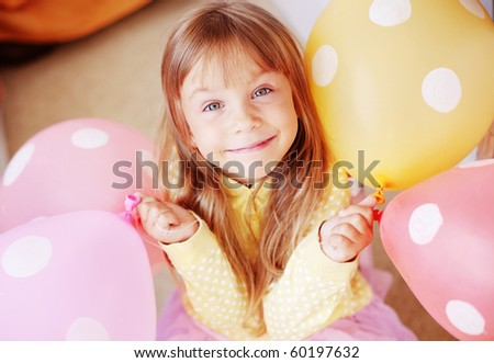 Happy child holding bunch of air balloons - stock photo