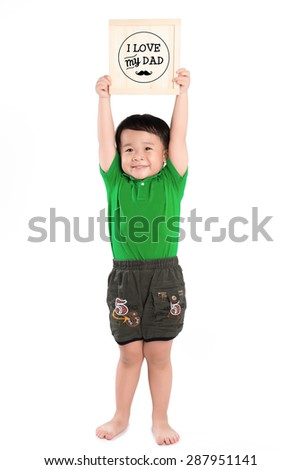 """Happy child holds up a drawing for his Dad; """"I Love Daddy"""" - stock photo"""