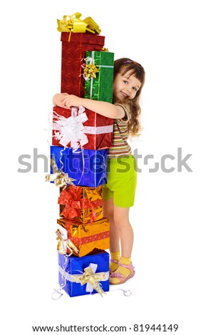 Happy child hugs gifts in boxes - stock photo