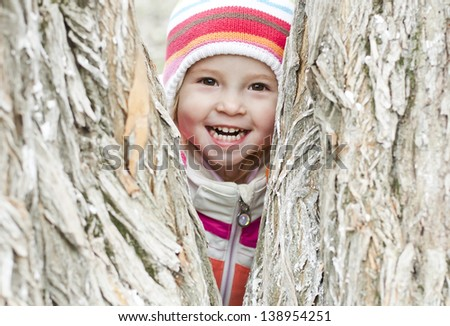 happy child in a park in the striped hat - stock photo