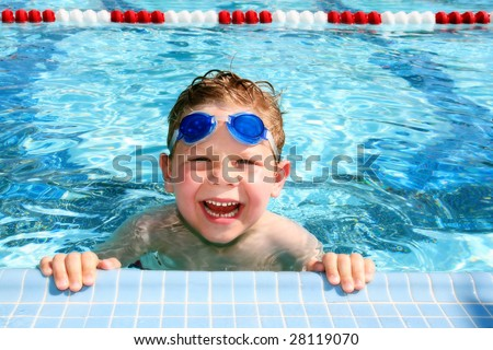 Happy child in a sunny swimming pool - stock photo