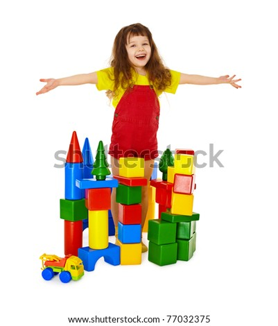 Happy child in a toy castle isolated on white background - stock photo