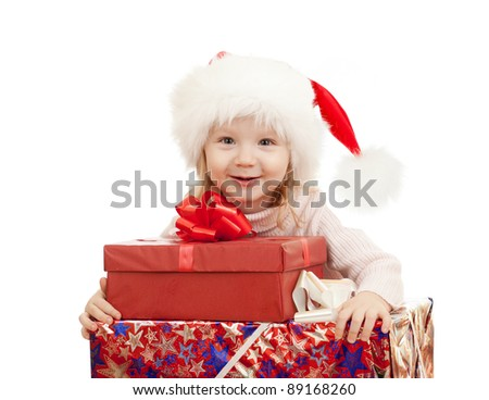happy child in Christmas Santa's hats with gift boxes - stock photo
