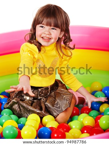 Happy child in group colourful ball. Isolated. - stock photo
