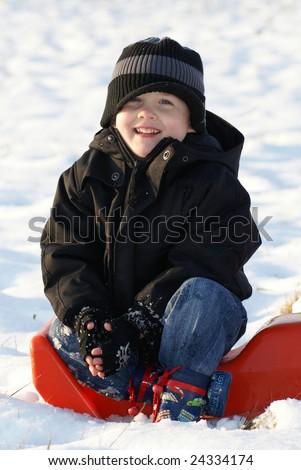 happy child in snow - stock photo