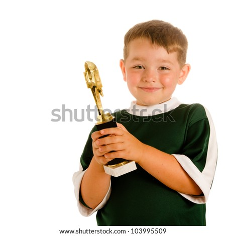 Happy child in soccer or football uniform with trophy isolated on white - stock photo