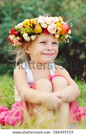 Happy Child in Summer.  Beautiful Girl with Flowers Wreath Outdoor. Happy Children. Healthy Kids. Spring Time. - stock photo