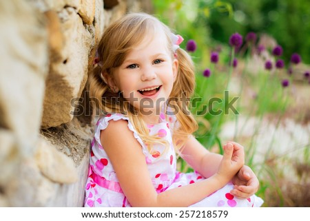 happy child in the spring park - stock photo