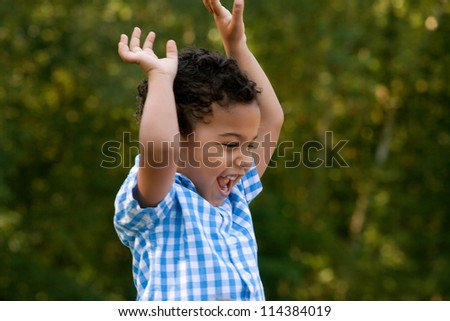Happy child in the summer - stock photo