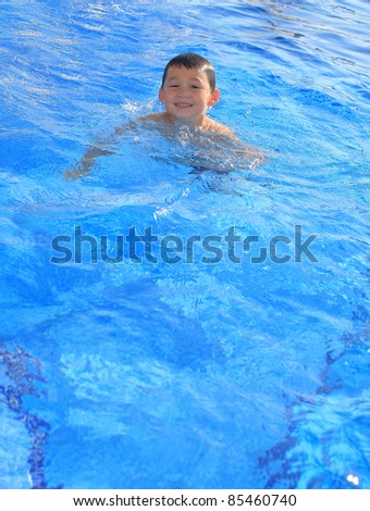 happy child in the swimming pool
