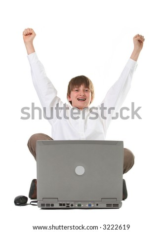 happy child infront of laptop, arms up suggesting victory or accomplishment, isolated on white