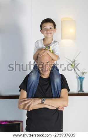 Happy Child Joke With Dad At Home - stock photo