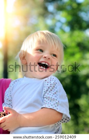 Happy Child laugh in the Summer Park - stock photo