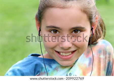 Happy child listening to music with headphones on. - stock photo