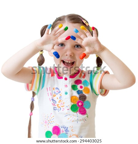happy child looking through painted hands - stock photo