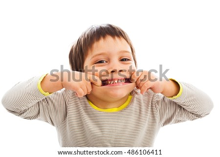 Happy child making funny face, stretching his cheeks