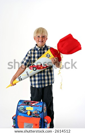 Happy child on his first schoolday with a traditional German Schultuete - stock photo