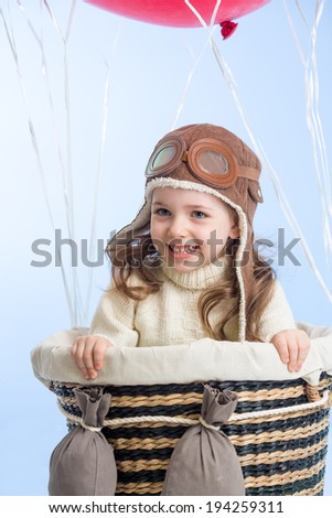 happy child on hot air balloon in the sky - stock photo